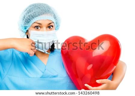 african american nurse holding heart - stock photo