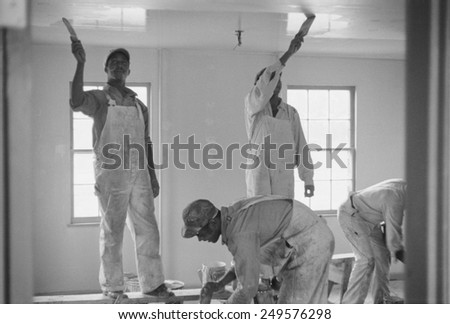 African American painters at Newport News Homesteads, Virginia, Sept. 1936. The New Deal project was designed, built, and would be managed by, and lived in by African American residents. - stock photo