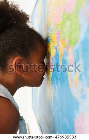 African american preschool girl near the map