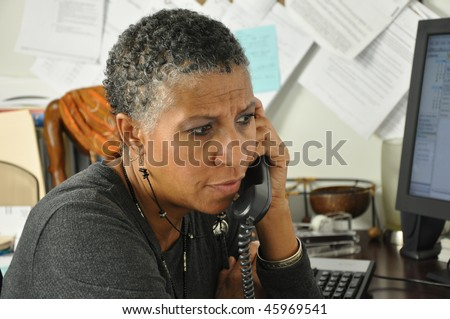 African American Professional Woman Listening on Phone Serious Facial Expression - stock photo