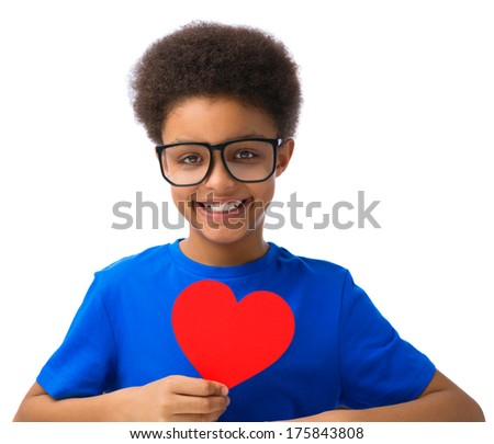 African American school boy, teenager with eyeglasses smiling and holding Valentines Heart. Isolated, over white background, with copy space. - stock photo