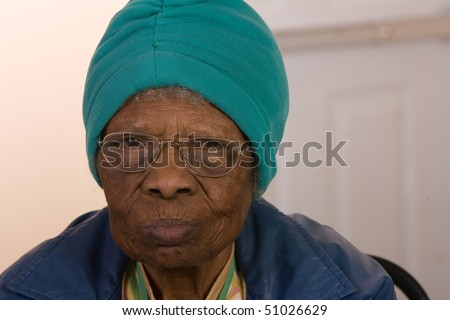 African American senior citizen woman wearing glasses - stock photo