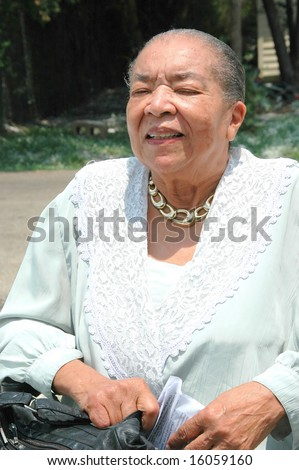 African american senior dressed for a church outing.