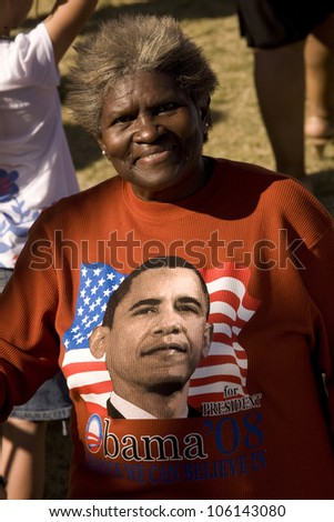 African American senior woman in red sweat shirt at Early Vote for Change Barack Obama Presidential rally at Bonanza High School, Judy K. Cameron Stadium in Las Vegas, NV, October 25, 2008