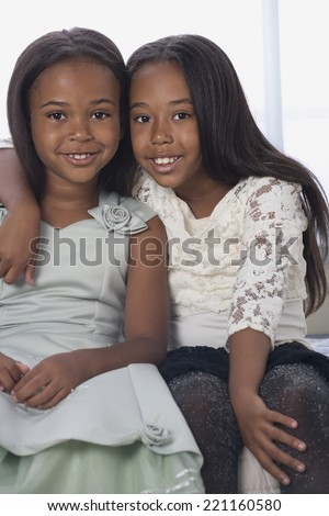 African American sisters hugging - stock photo
