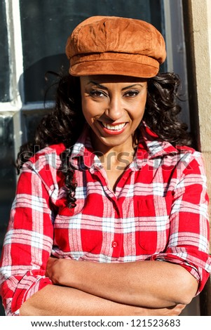 African American smiling woman wearing a hat