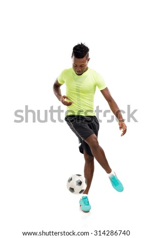 African-American soccer player dribbling a ball, isolated on while - stock photo