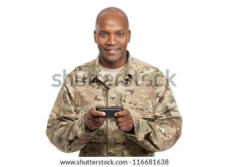 African american soldier texting on cellphone - stock photo
