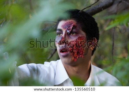 African American Teenager Zombie in the park - stock photo