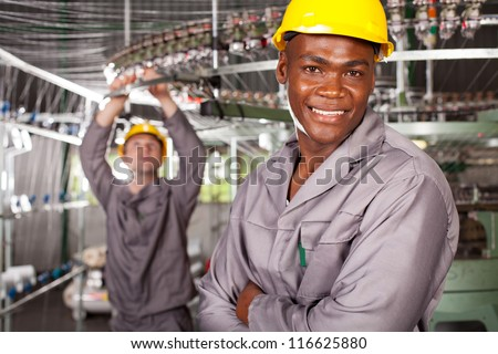 african american textile worker portrait in factory - stock photo