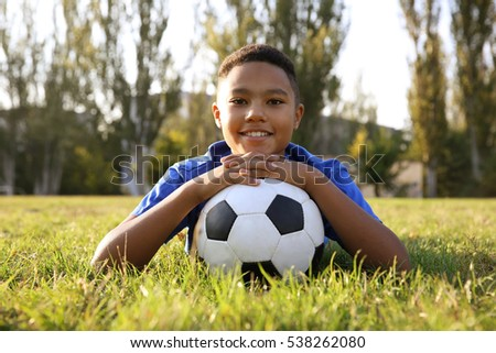 African American with football ball on field