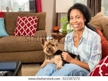African american woman and her dog at home