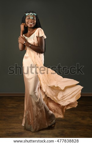 African American woman dressed in evening gown