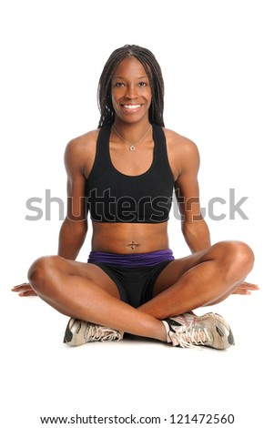 African American woman dressed in workout clothing sitting over white background - stock photo