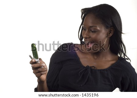 african american woman excited about a cell message