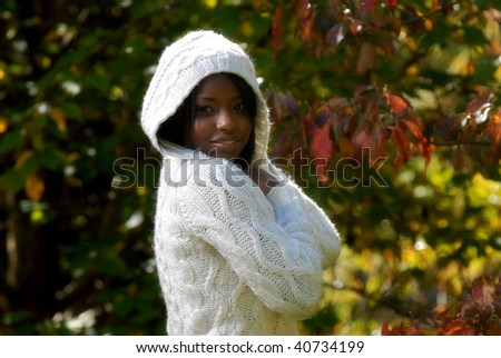 African-American woman feeling a cool fall day - stock photo