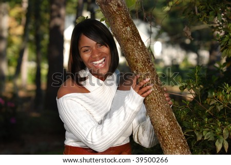 African-American woman full of joy smiling - stock photo