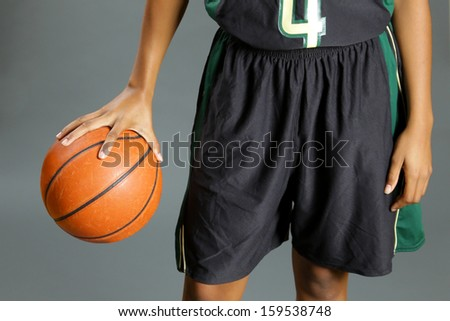 African American woman holding basketball