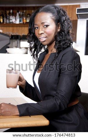 African American Woman is drinking coffee at a coffee shop