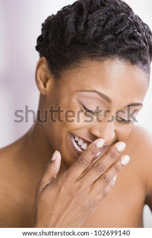 African American woman laughing - stock photo