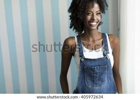 African american woman posing by the wall
