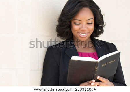 African American woman reading The Bible - stock photo