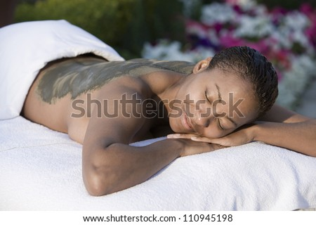 African American woman relaxing on massage table - stock photo