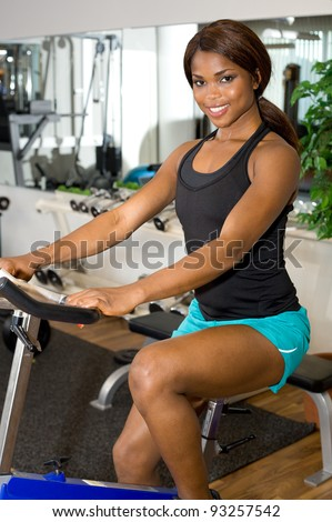 African American woman riding an exercise bike