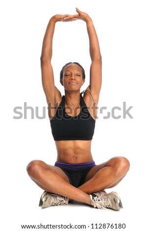 African American woman stretching in sitting position isolated over white background - stock photo