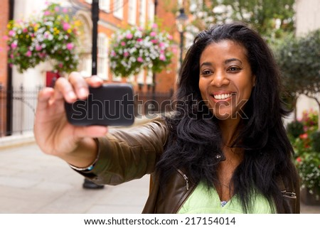 african american woman taking a selfie.  - stock photo