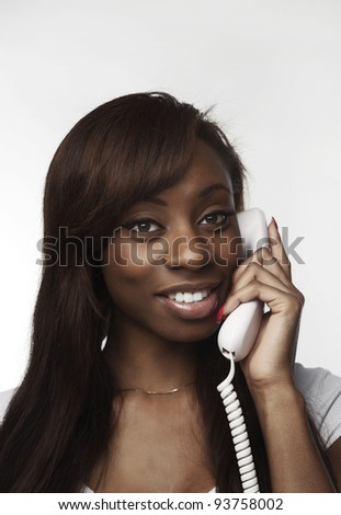 african american woman talking on the phone and she looks happy - stock photo