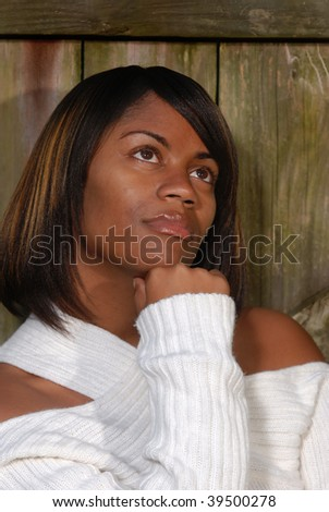 African-American woman thinking while looking to the sky