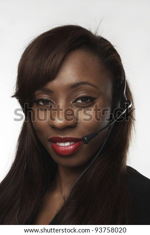 african american woman using a headset to talk to someone on the phone