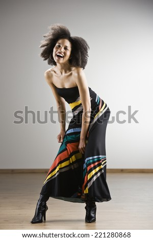 African American woman wearing strapless dress - stock photo