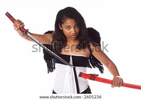 African American woman with black wings draws her ninja sword from it's sheath - stock photo