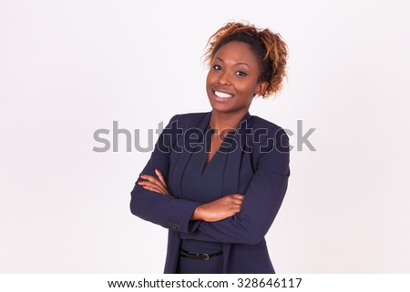 African American woman with folded arms, isolated on grey background - Black people