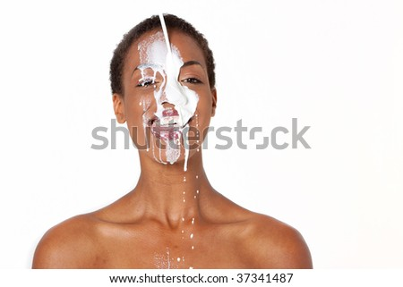 African American woman with milk on her face