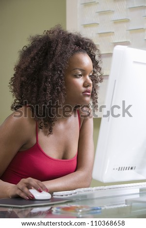 African American woman working on computer - stock photo