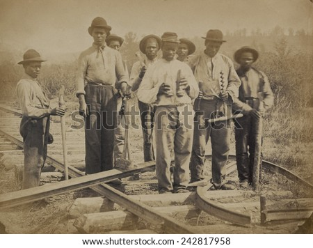 African American work team on a northern Virginia railroad in 1862 or 1863. Photo by Andrew J. Russell. - stock photo