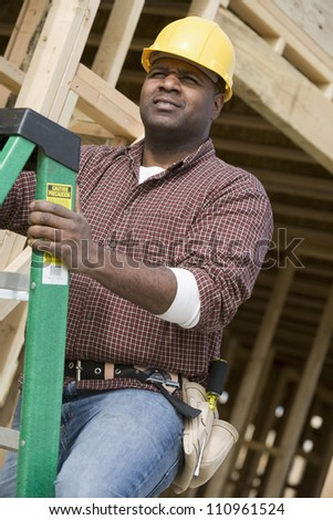 African american worker examining form work at construction site - stock photo