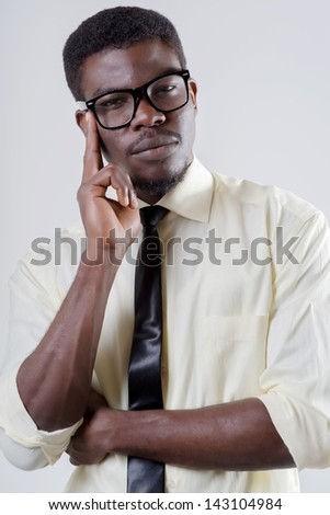 African-American young man holding his head