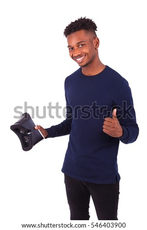 African American young man holding vr virtual reality headset over white background
