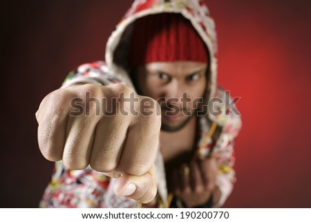 African american young man making a fist. Selective focus. - stock photo
