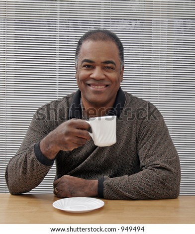 african americn man drinking coffee smiling - stock photo