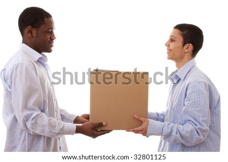 african and caucasian men holding cardboard box
