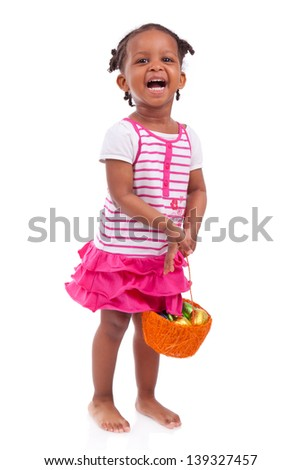 African Asian girl holding chocolate ester egg, isolated on white background