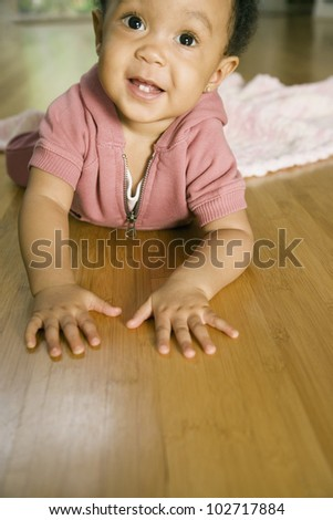 African baby laying on floor - stock photo