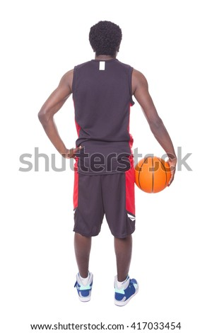 African basketball player from the back, isolated on white background - stock photo