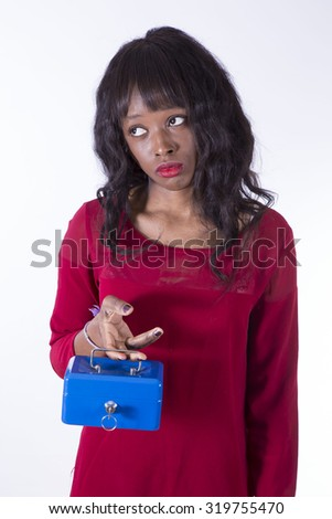 African beautiful girl with a safe - stock photo