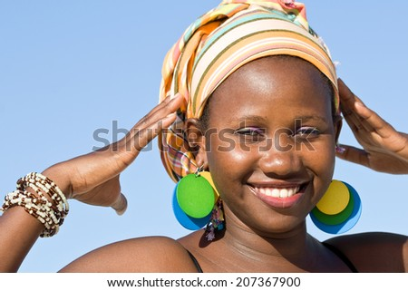 African beauty showing her accessories. - stock photo